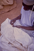 view A man embroidering a piece of cloth, Mopti, Mali digital asset: A man embroidering a piece of cloth, Mopti, Mali