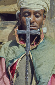view Marilyn Heldman digital asset: A Priest holding a cross, Aromo, Eritrea
