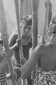view Women of Mallam Baba's household pounding grain, Yelwa, Nigeria digital asset: Women of Mallam Baba's household pounding grain, Yelwa, Nigeria