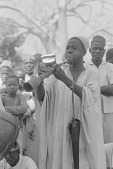 view Hausa musician playing a pipe during a harvest celebration, Nigeria digital asset: Hausa musician playing a pipe during a harvest celebration, Nigeria