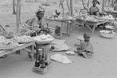 view Kamberi women selling food at a village market, Yelwa, Nigeria digital asset: Kamberi women selling food at a village market, Yelwa, Nigeria