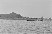 view Two young men rowing in a canoe on the Kainji Reservoir, Kainji Reservoir region, Nigeria digital asset: Two young men rowing in a canoe on the Kainji Reservoir, Kainji Reservoir region, Nigeria