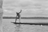 view A man fishing from a dugout canoe on the Kainji Reservoir, Kainji Reservoir region, Nigeria digital asset: A man fishing from a dugout canoe on the Kainji Reservoir, Kainji Reservoir region, Nigeria