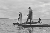 view Men fishing from a dugout canoe on the Kainji Reservoir, Kainji Reservoir region, Nigeria digital asset: Men fishing from a dugout canoe on the Kainji Reservoir, Kainji Reservoir region, Nigeria