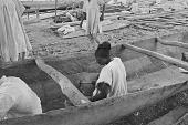 view A man repairing a dugout canoe on the shore of Kainji Reservoir, Kainji Reservoir region, Nigeria digital asset: A man repairing a dugout canoe on the shore of Kainji Reservoir, Kainji Reservoir region, Nigeria