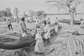 view People repairing a large dugout canoe on the Kainji Reservoir, Kainji Reservoir region, Nigeria digital asset: People repairing a large dugout canoe on the Kainji Reservoir, Kainji Reservoir region, Nigeria