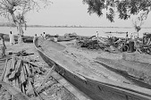 view A large dugout canoe needing repair on the shore of Kainji Reservoir, Kainji Reservoir region, Nigeria digital asset: A large dugout canoe needing repair on the shore of Kainji Reservoir, Kainji Reservoir region, Nigeria