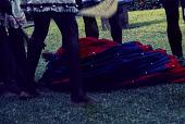 view Ogumogu dancer performer on the ground during an Afenmai-Ekperi Ogumogu dance performance at a National Museum of Lagos Exhibition, Lagos, Nigeria digital asset: Afenmai-Ekperi Ogumogu Dance Performance, Detail - Ogumogu on Ground, National Museum of Lagos Exhibition, Lagos, Nigeria