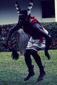 view Dancer during an Afenmai-Ekperi Ogumogu performance at a National Museum of Lagos Exhibition, Lagos, Nigeria digital asset: Afenmai-Ekperi Ogumogu Dance Performance, Detail - Single Dancer, National Museum of Lagos Exhibition, Lagos, Nigeria