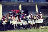 view Dance performers carrying an Ogumogu dancer during an Afenmai-Ekperi Ogumogu performance at a National Museum of Lagos Exhibition, Lagos, Nigeria digital asset: Afenmai-Ekperi Ogumogu Dance Performance, Detail - Group Carrying Ogumogu, National Museum of Lagos Exhibition, Lagos, Nigeria