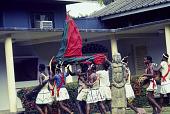 view Dance performers carrying an Ogumogu dancer during an Afenmai-Ekperi Ogumogu performance at a National Museum of Lagos Exhibition,, Lagos, Nigeria digital asset: Afenmai-Ekperi Ogumogu Dance Performance, Detail - Group Carrying Ogumogu, National Museum of Lagos Exhibition, Lagos, Nigeria