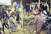 view Sue Foss taking pictures at a market in Ughelli, Ughelli, Delta State, Nigeria digital asset: Sue Foss/Trade Goods, Ughelli Market Day, Ughelli, Delta State, Nigeria