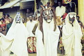 view Ekpe Urhobo Masquerade performers dancing during a Leaf Masquerade, Ohoro Town, Nigeria digital asset: Urhobo Masqueraders One, Two, and Three (Left to Right), Ekpe, Leaf Masquerade, Ohoro Town, Nigeria