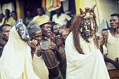 view Ekpe Urhobo Masquerade performers dancing during a Leaf Masquerade, Ohoro Town, Nigeria digital asset: Urhobo Masqueraders One and Two, Ekpe, Leaf Masquerade, Ohoro Town, Nigeria