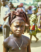 view A young girl with face paint and a heart necklace, Okpella, Nigeria digital asset: A young girl with face paint and a heart necklace, Okpella, Nigeria