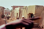 view George Rohrmann Collection digital asset: Hand obscuring view of Hausa village, Kano, Nigeria
