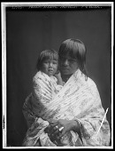 view Portrait of Santa Clara woman holding small child. Logbook title Santa Clara mother and child digital asset: Portrait of Santa Clara woman holding small child. Logbook title Santa Clara mother and child