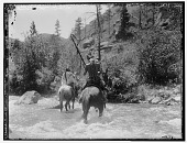 view Two Crow men fording river on horses. Logbook title The Ford digital asset: Two Crow men fording river on horses. Logbook title The Ford