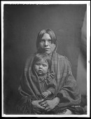 view Portrait of Taos woman holding young child. Logbook title Babe and Parent digital asset: Portrait of Taos woman holding young child. Logbook title Babe and Parent