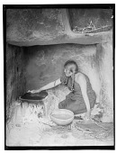 view Hopi woman making piki bread on baking stone. Published as Piki Maker digital asset: Hopi woman making piki bread on baking stone. Published as Piki Maker