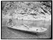 view Yurok man in canoe on the Trinity River. Published as Yurok Canoe on Trinity River digital asset: Yurok man in canoe on the Trinity River. Published as Yurok Canoe on Trinity River