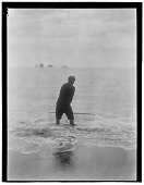 view Yurok man fishing in surf for smelt digital asset: Yurok man fishing in surf for smelt