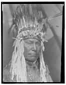 view Piegan man wearing feather headdress. Published as Piegan War-Bonnet digital asset: Piegan man wearing feather headdress. Published as Piegan War-Bonnet