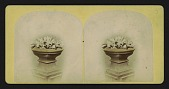 view [urn on a pedestal with flowers in urn] digital asset: [urn on a pedestal with flowers in urn]