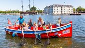 view Fishing for Plastic Is the Latest Way to Clean Up Amsterdam's Canals digital asset number 1