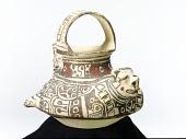 view Loop-handle vessel depicting a jaguar and coyote digital asset number 1