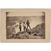view Three Men at Shoshone Falls (figure at left is possibly photographer William Henry Jackson) digital asset number 1