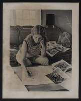 thumbnail image for Anne Arnold making a preliminary sketch for her sculpture <em>Wall pig</em>