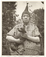 view Diego Rivera holding a dog digital asset number 1