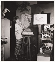 thumbnail image for Photograph of Rhys Caparn with cat in her studio