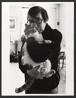 view Photograph of Berenice Abbott holding a cat digital asset number 1