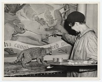thumbnail image for Emily Barto painting <em>Animal Tales</em> with cat