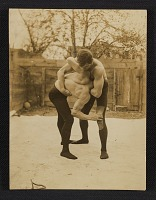 thumbnail image for Two men wrestling in a courtyard