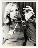 thumbnail image for Arline M. Fisch holding a necklace