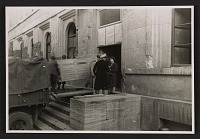thumbnail image for One panel of the Ghent Altarpiece being loaded onto a truck at the Munich Collecting Point