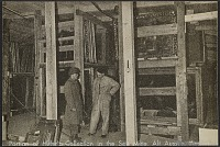 thumbnail image for Two men standing by racks of paintings inside a salt mine in Altaussee, Austria