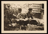 view Ethel Pennewill Brown and Olive Rush reading outside digital asset number 1