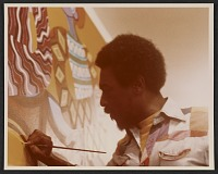 thumbnail image for Charles Searles painting a mural