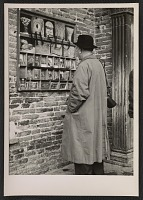 thumbnail image for Ben Shahn looking at postcards