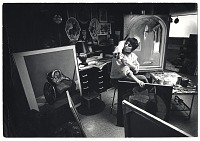 thumbnail image for Photograph of Carol Wald with a cat in her studio
