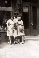 view Chester Lee Harris papers digital asset: Lee and Chester Harris, godmother Bessie, and Henrietta Brown pose in front of building