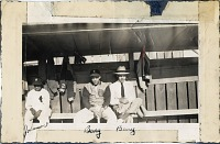 view Anacostia Aztecs baseball players (Johnson, Berry) sitting in dugout digital asset: Anacostia Aztecs baseball players (Johnson, Berry) sitting in dugout