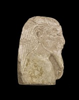 view Fragment of soft sandstone (?) covered with plaster. Head and shoulders of a man cut in relief in the plaster. digital asset number 1
