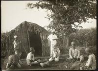 view Men Outside a Hut digital asset: Men Outside a Hut [graphic]