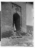 view Radkan (Iran): Tomb Tower at Radkan, West: View of Remains of Inscription Marking the Top of the Arched Entrance digital asset: Radkan (Iran): Tomb Tower at Radkan, West: View of Remains of Inscription Marking the Top of the Arched Entrance [graphic]