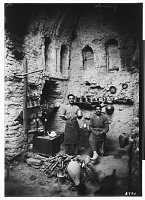 """view Excavation of Kuh-e Khwaja (Iran): Ruins of Ghaga-Shahr, """"Palace-Temple"""" Complex, South Gate: View of Ernst Herzfeld's Expedition Crew Members and Improvised Kitchen digital asset: Excavation of Kuh-e Khwaja (Iran): Ruins of Ghaga-Shahr, """"Palace-Temple"""" Complex, South Gate: View of Ernst Herzfeld's Expedition Crew Members and Improvised Kitchen [graphic]"""